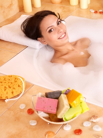 young girl bath: Woman relaxing in bubble bath . Stock Photo