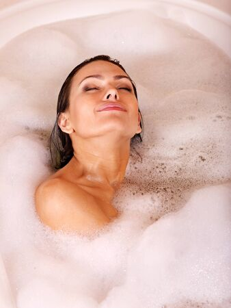 fürdő: Woman relaxing in bubble bath . Stock fotó