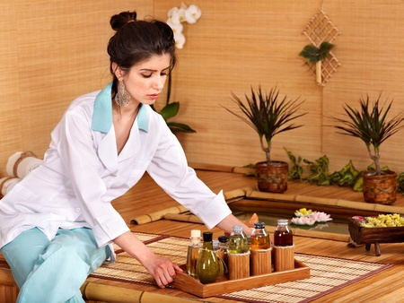 Bamboo massage at spa and woman. Stock Photo - 9620312