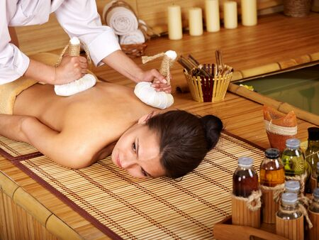 hydrotherapy: Young woman getting massage in bamboo spa.