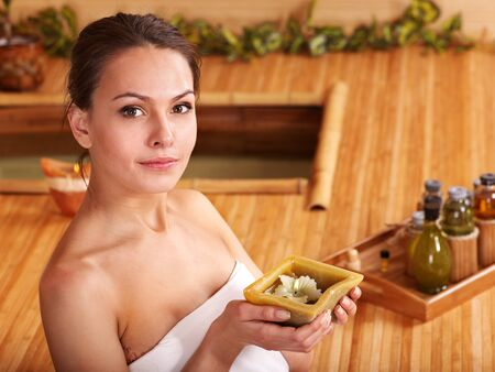 Bamboo massage at spa and woman. Stock Photo - 9620245