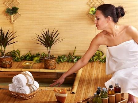 Bamboo massage at spa and woman. photo