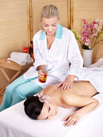 Young beautiful woman on massage table in beauty spa. Series. Stock Photo - 9780136