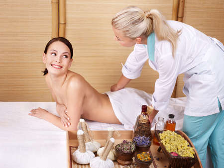 Young beautiful woman on massage table in beauty spa.  Series. Stock Photo - 9780452