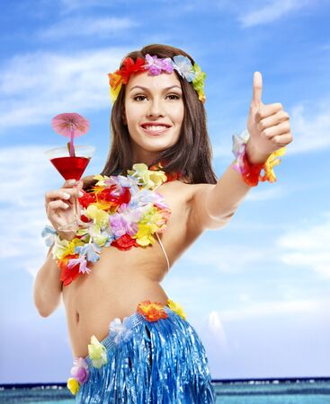 Woman in hawaii costume drink  juice. Stock Photo