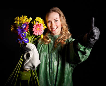 Thumb up of young woman  with gas mask and flowers.   photo