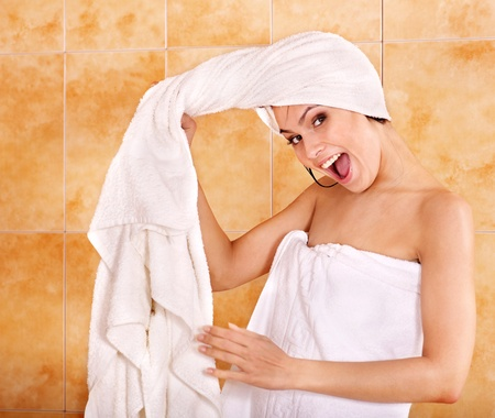 girl with towel: Young woman take bubble  bath.