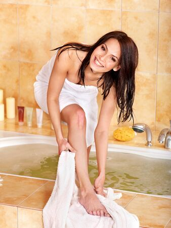wiping: Young woman take bubble  bath.
