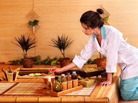 Bamboo massage at spa and woman. Stock Photo - 9780583
