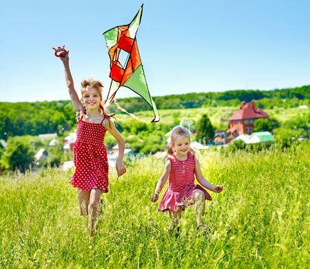 Group children flying kite outdoor.  photo