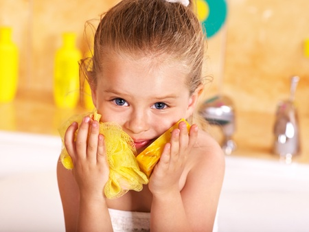 relaxion: Child washing in bubble bath . Stock Photo