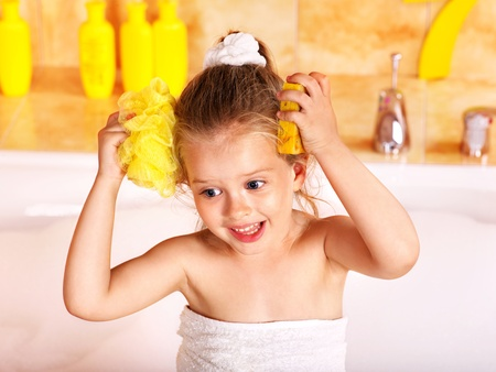 Child washing in bubble bath . Stock Photo - 9780122