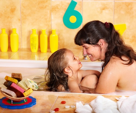 Mother and child washing in bubble bath . Stock Photo - 9780306