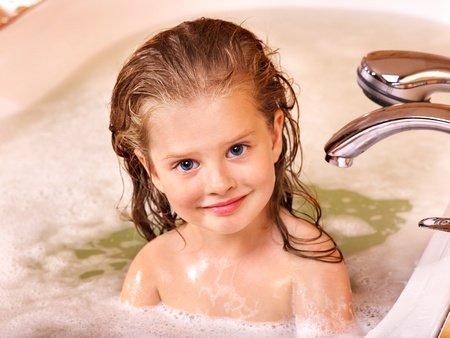steam bath: Child washing in bubble bath . Stock Photo