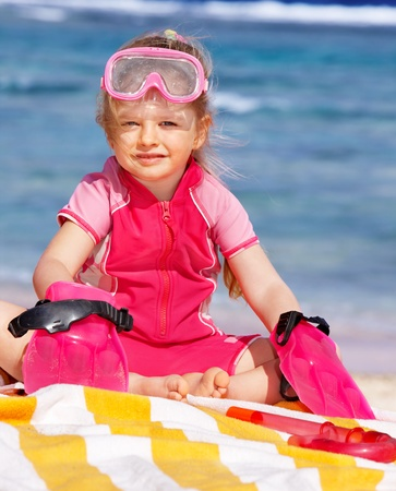 Child  playing on  beach. Stock Photo - 9780981