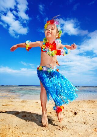 Little girl  playing on  Hawaii beach . Stock Photo