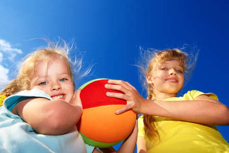 kids playground: Childrenl playing with ball. Outdoor.