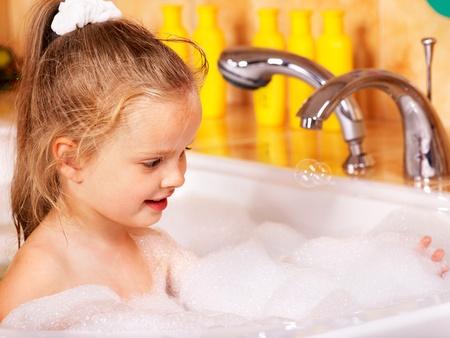 bubble bath: Child washing in bubble bath . Stock Photo