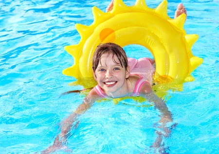 Children sitting on inflatable ring in swimming pool. Stock Photo - 9898391