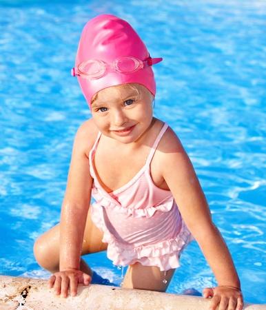 swim goggles: Little girl  swimming in pool. Stock Photo