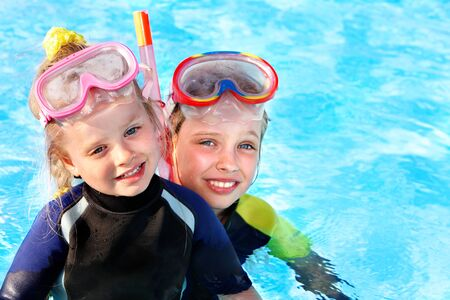 Children in swimming pool learning snorkeling. Sport. Stock Photo - 9898291