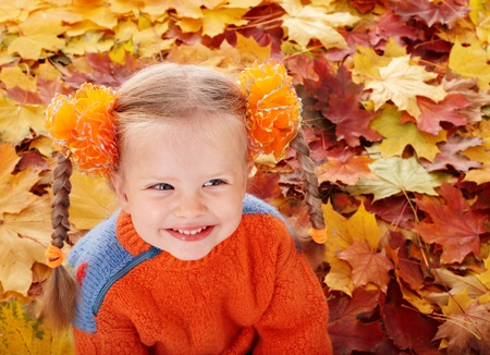 Girl child in autumn orange leaves. Outdoor. Stock Photo - 9898357