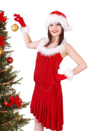 Girl in santa hat holding  christmas ball.  Isolated. Stock Photo - 9897941