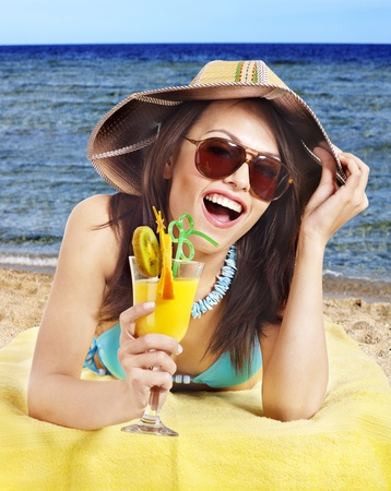 Girl in bikini on beach drinking cocktail. Stock Photo - 9897954