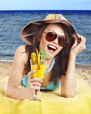 Girl in bikini on beach drinking cocktail. Stock Photo - 9897954