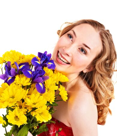 Young woman holding  flowers. Isolated. photo