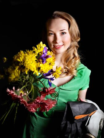 Young woman holding flowers and gas mask . Stock Photo - 9898356