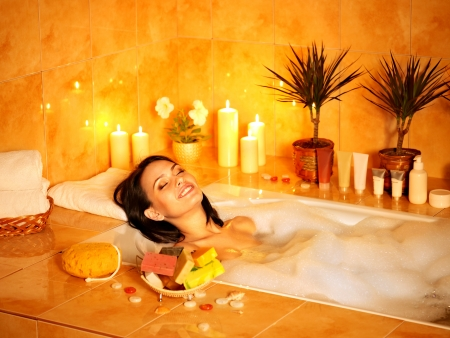 pamper: Young woman take bubble  bath.