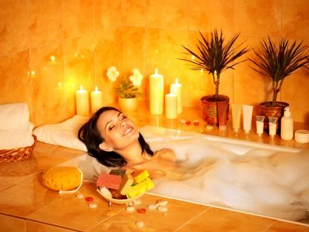 bath towel: Young woman take bubble  bath.