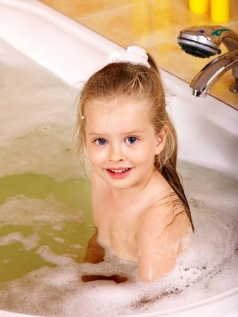 Child washing in bubble bath . Stock Photo - 9898634