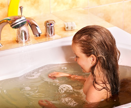 steam room: Child washing in bubble bath . Stock Photo