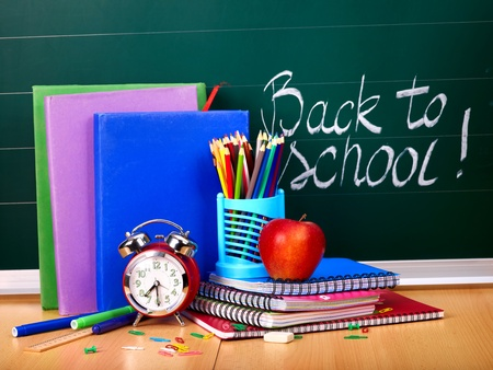 school notebook: Back to school supplies and board. Stock Photo