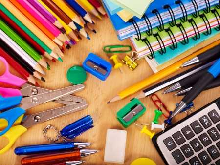 office stationery: School  office supplies on board. Stock Photo