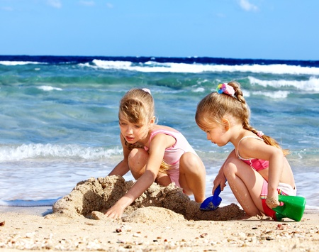 Little girl  playing on  beach. Stock Photo - 9899290