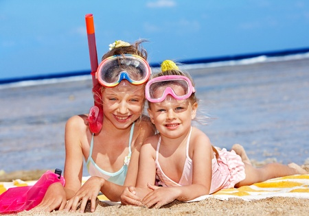 swim mask: Children playing on  beach. Snorkeling.
