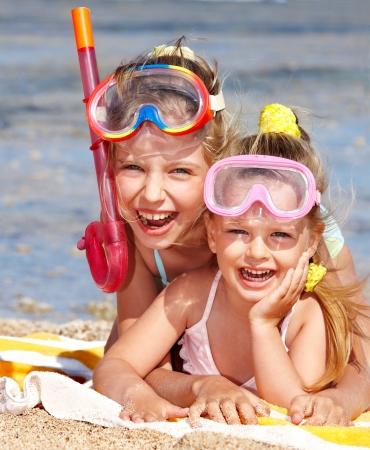 Children playing on  beach. Snorkeling. Stock Photo - 9899339