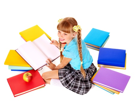 Child with pile of books  reading on floor. Isolated. photo