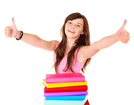 Girl with pile book showing thumb up. Isolated. Stock Photo - 9899311