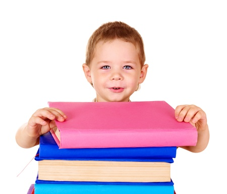Little boy holding stack of books. photo