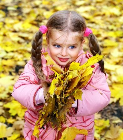 Child in autumn orange leaves. Outdoor. Stock Photo - 9899420