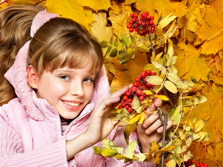Child in autumn orange leaves. Outdoor. Stock Photo - 9899621