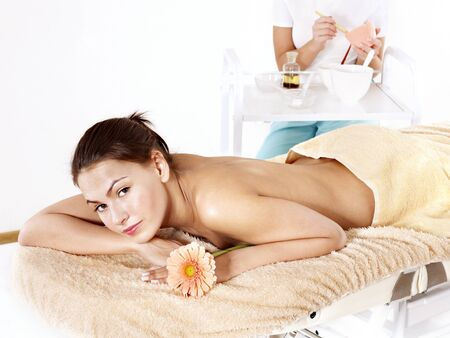 beauty parlour: Young beautiful woman on massage table in beauty spa. Series.