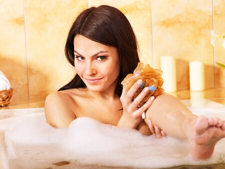 woman bath: Young woman take bubble  bath.