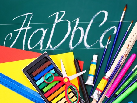 Art  school supplies and alphabet. photo