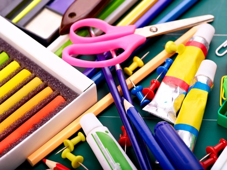 Background of group school supplies. photo