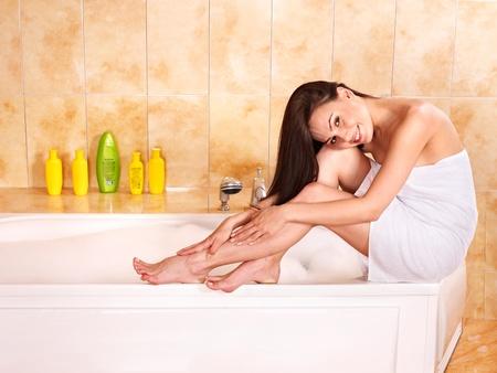 bathrobes: Young woman take bubble  bath.